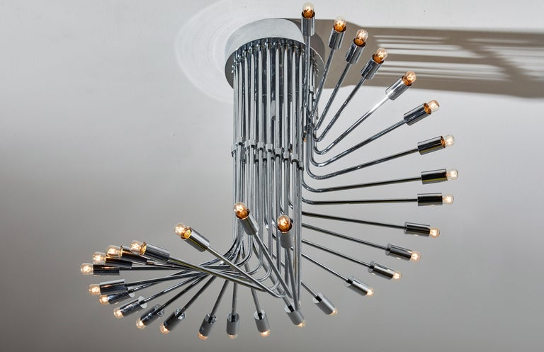 Suspension light by Reggiani. Manufactured in Italy, circa 1970s. Chrome-plated brass. Rewired for U.S. junction boxes. Takes 30 E27 25W maximum bulbs. Bulbs provided as a one time courtesy.
