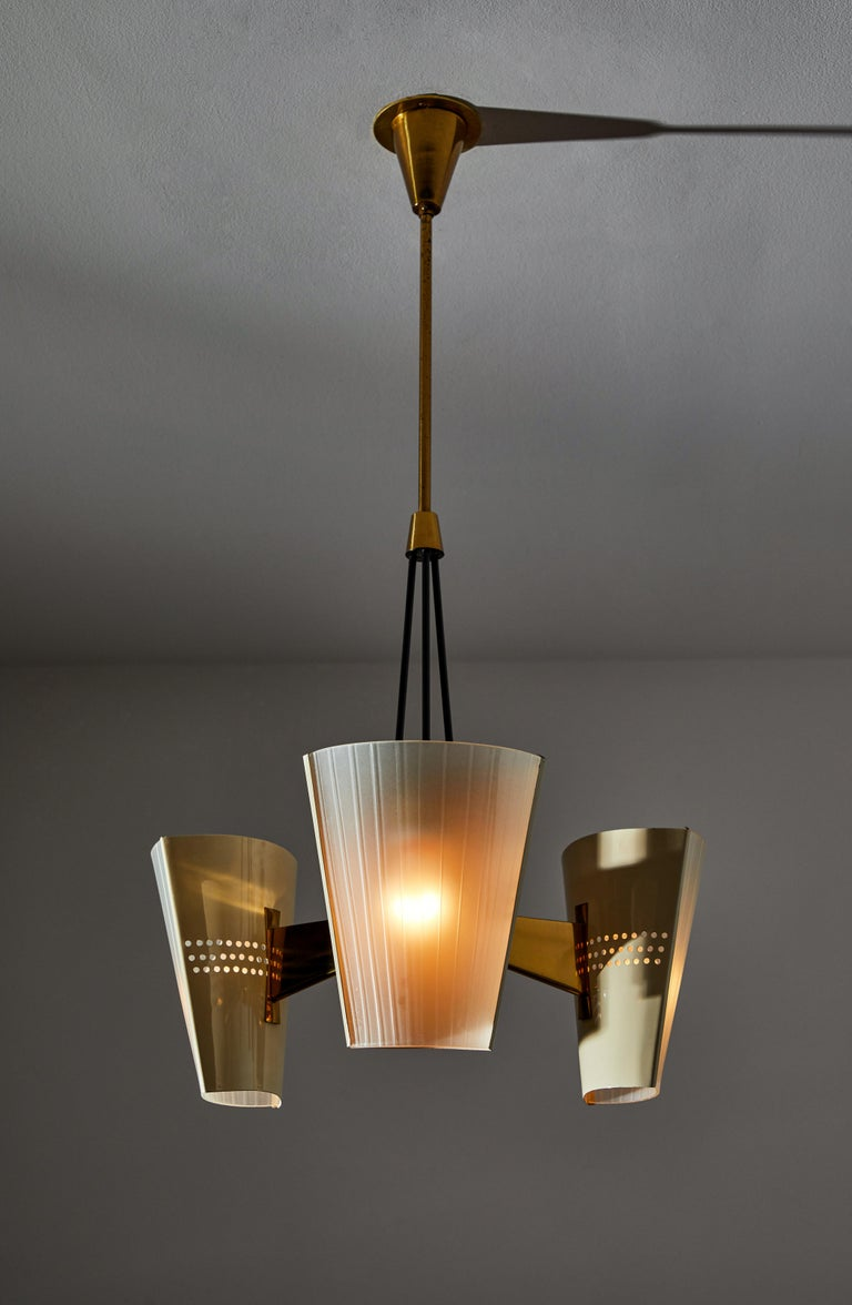 Suspension light by Stilnovo. Manufactured in Italy, circa 1950s. Enameled metal, etched glass. Rewired for U.S. standards. Custom brass ceiling plate. We recommend three E27 60w maximum bulbs. Bulbs included as a one time courtesy.