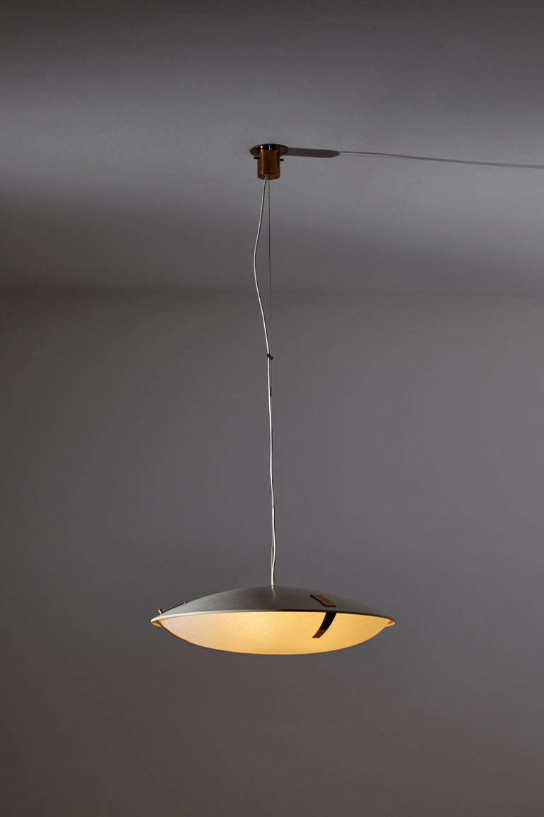 Suspension light by Stilnovo. Manufactured in Italy, circa 1960s. Enameled metal, textured glass diffuser, brass accents. Rewired for U.S. standards. Original canopy, custom brass ceiling plates. We recommend three E26 100w maximum bulbs. Bulbs