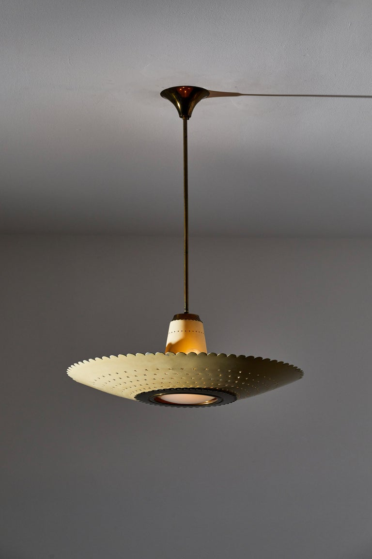 Suspension light by Stilux. Designed and manufactured in Italy, circa 1950s. Lacquered metal and brass, glass lens. Custom brass ceiling plate. Rewired for U.S. standards. We recommend four E14 25w maximum bulbs and one E26 40w maximum bulb. Bulbs