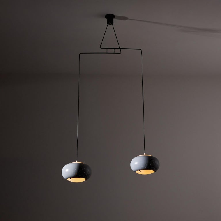 Suspension light by Stilux. Manufactured in Italy, circa 1950's. Enameled metal, glass brass, custom brass backplates. Rewired for U.S. standards. We recommend two E27 100w maximum bulbs. Bulbs provided as a one time courtesy.