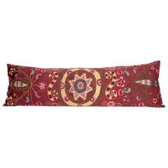 Suzani Body Pillow Fashioned from a Tashkent Suzani, Uzbekistan, 20th Century