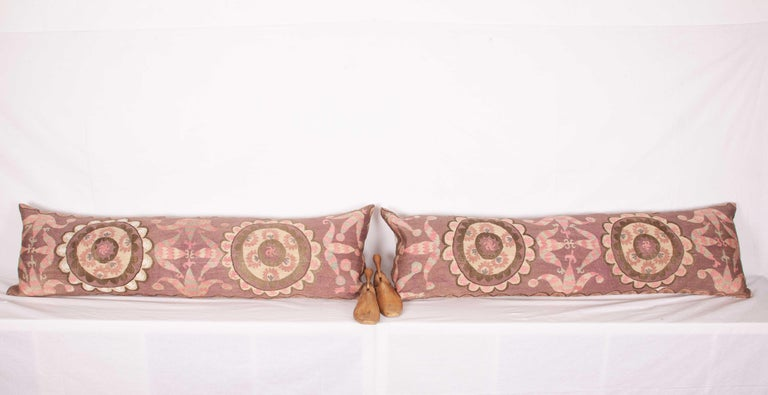 Uzbek Suzani Lumbar Pillow Cases Fashioned from All-Over Embroidered Tashket Suzani For Sale