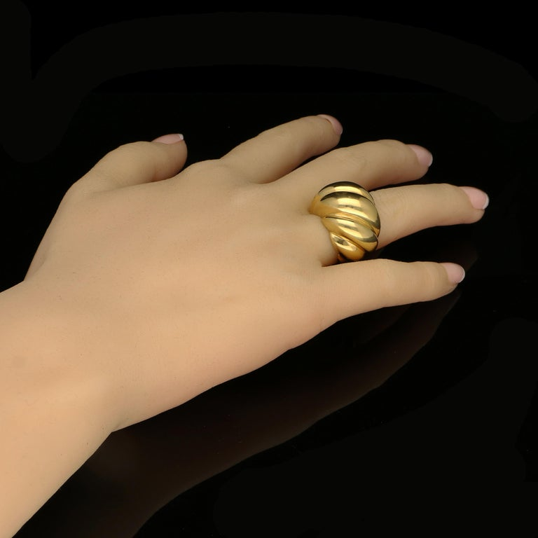 A bold and stylish 18 Carat Gold 'Torsade' ring by Suzanne Belperron c.1950, designed as a bombe style dome of twisted form tapering to a plain band  18ct yellow gold with French assay mark  17 grams  UK finger size K, can be adjusted to your own