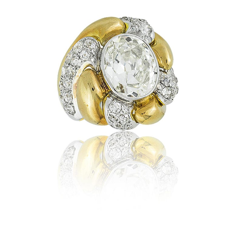 "Suzanne Belperron Platinum 18K Yellow Gold & Diamond ""Tourbillon"" Ring; Oval Cut Diamond  approx 5.40ct ;  Poinçon for Groene et Darde; French, Ca 1942 see: Suzanne Belperron by Sylvie Raulet / Olivier Baroin, pg 292"