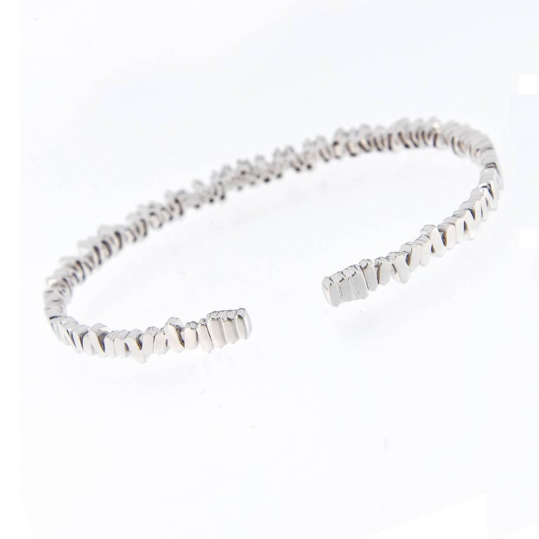 Suzanne Kalan says the best thing about her designs is that they look just as good with jeans as they do with an evening dress. This stunning flexible cuff bracelet is expertly crafted in 18k white gold with baguette diamonds. Weighs 12.3 grams.