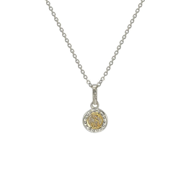 This elegant Suzy Levian diamond halo pendant displays round-cut diamonds on 14 karat white gold setting. This gorgeous pendant contains 20 white round cut diamonds totaling .35 cttw. The larger center stone is 4 mm in size and has a halo of 1 mm