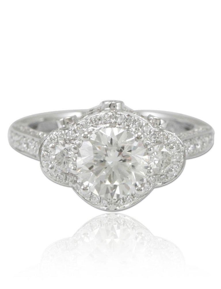 This spectacular ring from the Suzy Levian Limited Edition collection features a 18k white gold setting with a round-cut, fancy white diamond center stone (1.52ct) . An array of white diamonds (1.03cttw) accents the ring perfectly as the brilliance