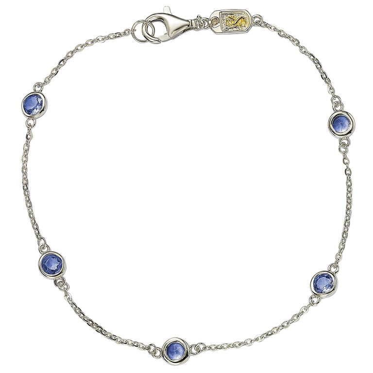 Adorn your hand with sparkling shimmers with this beautiful sapphire station bracelet. This bracelet can be worn stackable with other bracelets or as a single bracelet, making it the perfect bracelet for every occasion. This bracelet features five