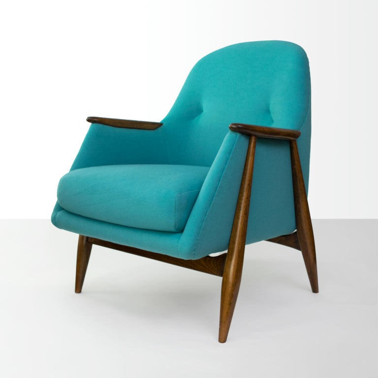 A Scandinavian Modern upholstered armchair with carved stained wood frame designed by Svante Skogh for Asko, Finland, 1954. Newly refinished and upholstered in soft 100% wool fabric.  Measures: Height 32.5