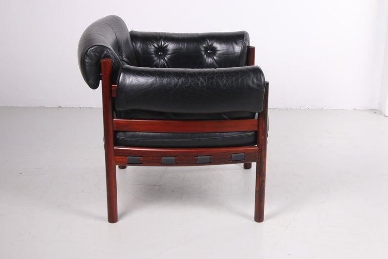 Swedish Sven Ellekaer for Coja black leather armchair 1970s
