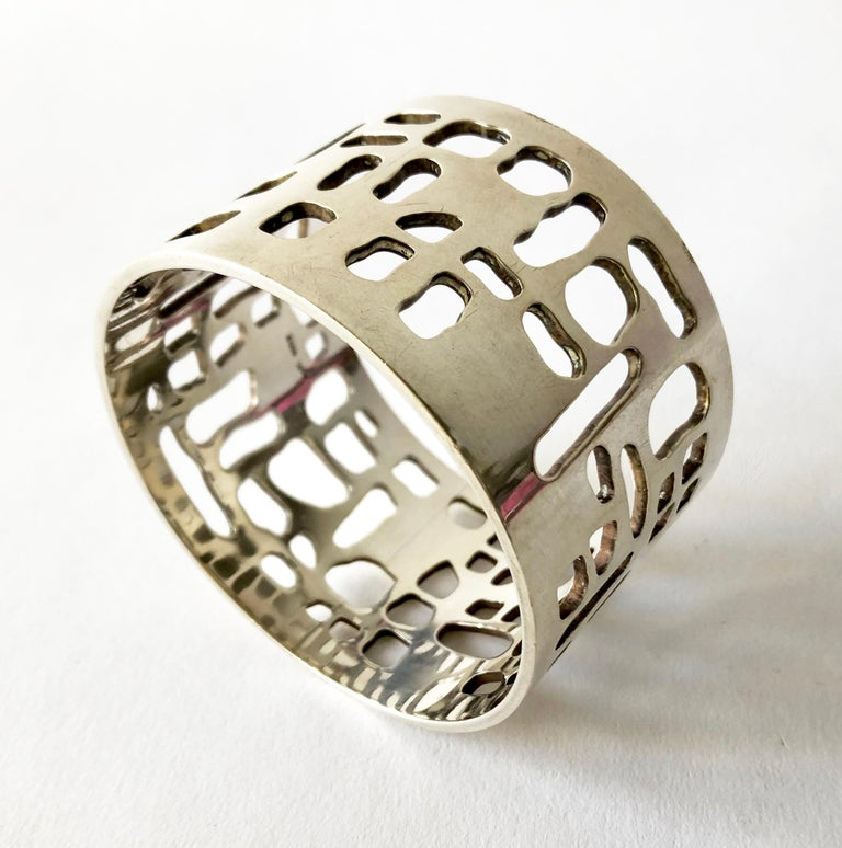 Sterling Silver bangle bracelet with abstract perforations created by Sven Haugaard of Denmark.  8.5