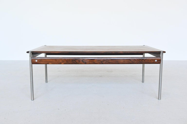 Stunning coffee table from 1001 series designed by Sven Ivar Dysthe for Dokka Mobler, Norway, 1957. This beautiful coffee table is executed in high quality beautiful grained rosewood and tubular steel legs. All parts are of a distinctly high quality