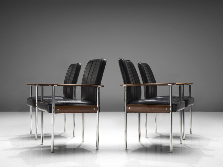 Sven Ivar Dysthe for Dokke Møbler, dining chairs, black leather, steel, rosewood, Norway, circa 1959.   This well crafted office chairs is designed by Sven Ivar Dysthe. The base of these office chairs is made out of rosewood, stainless steel