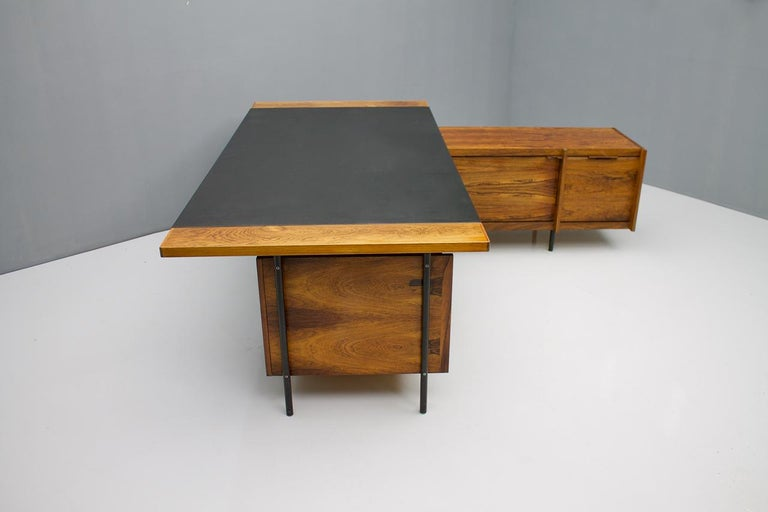 Rare desk by Sven Ivar Dysthe for Dokka Mobler, Norway from the 1960s.  All keys for the four drawers are available. There is no key for the roll cabinet on sideboard.  Good used partly restored condition.