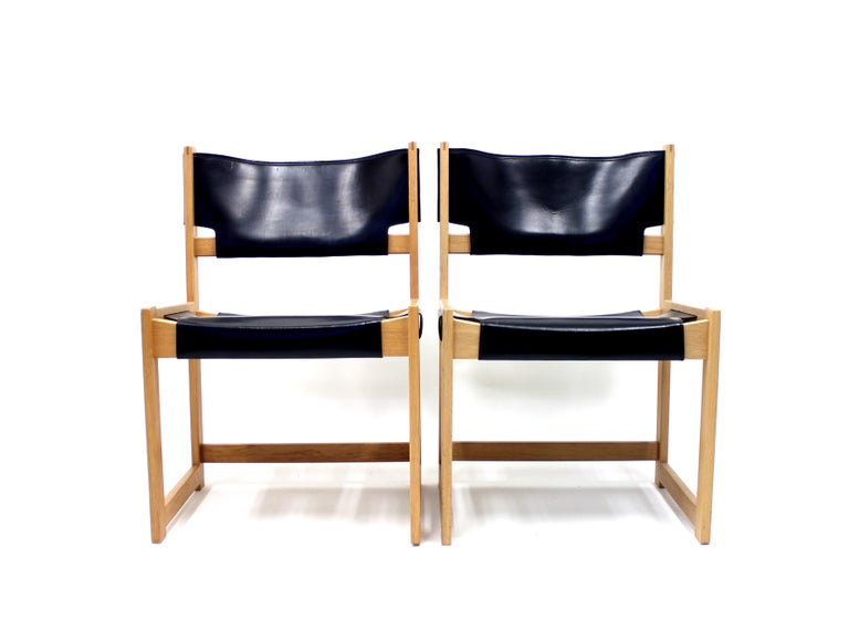 Armchair designed by Sven Kai Larsen for Swedish manufacturer Nordiska Kompaniet in the 1960s. It´s made of solid pine and black leather. Good vintage condition with some patina on the leather.