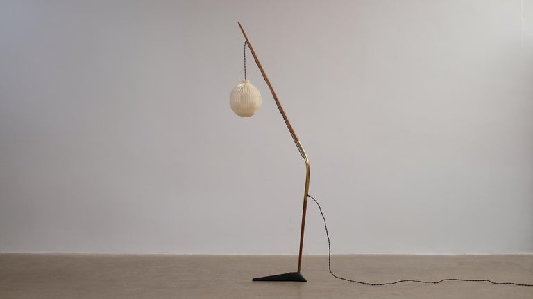 Rare and beautiful 'Fishing Pole' floor light designed by Svend Aage Holm Sorensen for Holm Sorensen and Co, Denmark. Cast iron base with teak and brass shaft. Shade by Le Klint.