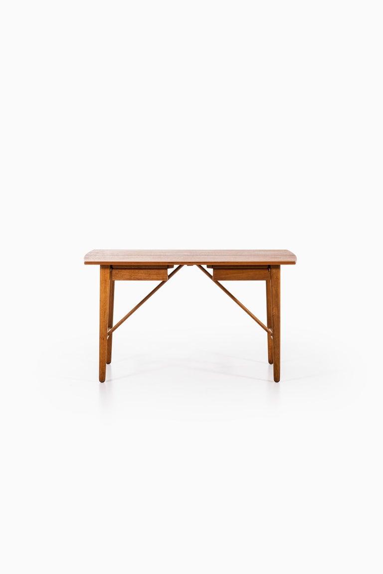 Rare desk designed by Svend Aage Madsen. Produced by K. Knudsen & Søn in Denmark.