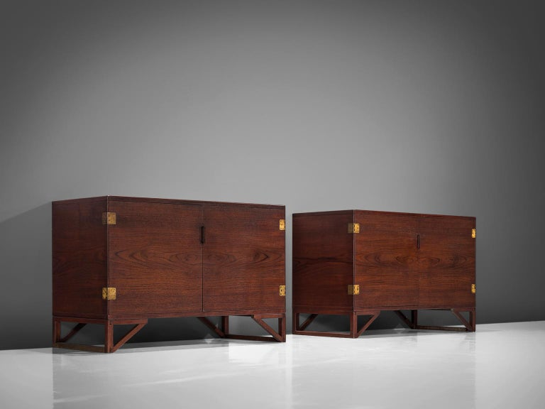 Svend Langkilde for Illum Bolighus, set of 2 cabinets in teak and brass, Denmark, 1965.  Modest and refined rosewood cabinets designed by Svend Langkilde, produced by Illums Bolighus. These sideboards are equipped with Langekilde's signature
