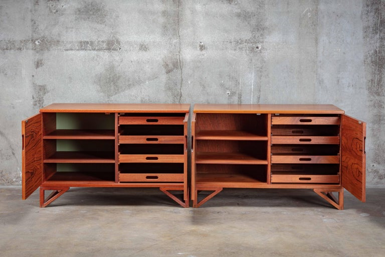 Svend Langkilde pair of teak cabinets mounted on runner legs manufactured by Langkilde Mobler.