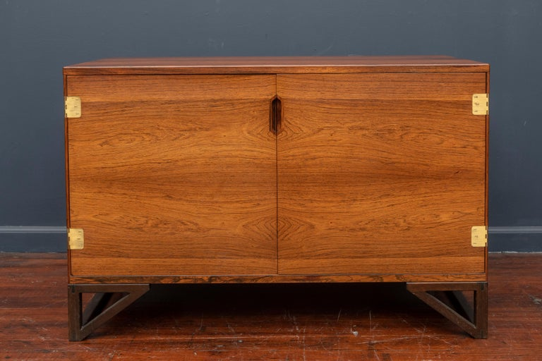Svend Langkilde design rosewood two-door cabinet with a fitted interior comprising drawers and adjustable shelves. In very good original condition.