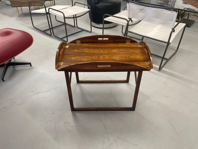A stunning 1960's rosewood butler's tray table by Svend Langkilde. Beautiful top. Have to say the graining on this example is one of the most striking. Tray top is removable. Brass cross stretcher on the sides of the base. Quite stable. Tray top