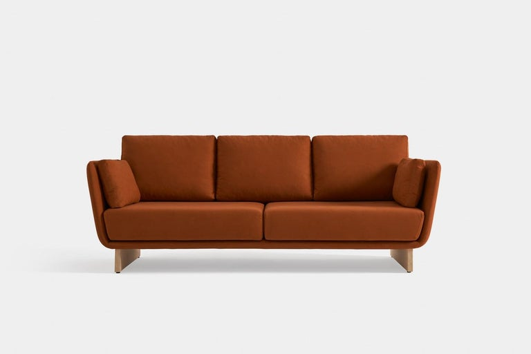 Swan sofa with wooden legs by Pepe Albargues Dimensions: W 196 x D 93 x H 92 cm Materials: Wood, Fibre MDF, Foam CMHR   Variations of materials are avaliable  Swan is a collection made up of an armchair and a sofa inspired by the beauty and