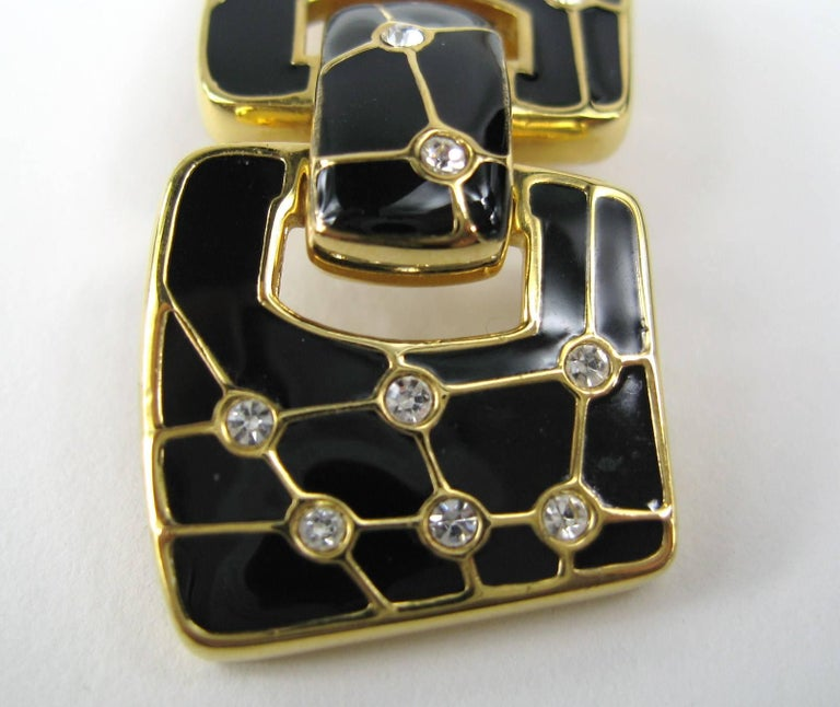 Black enameled Swarovski Enameled crystal dangle Clip on  earrings Measuring  1.70 in x .70 in. This is out of a massive collection of Hopi, Zuni, Navajo, Southwestern, sterling silver, costume jewelry and fine jewelry from one collector. Be sure to