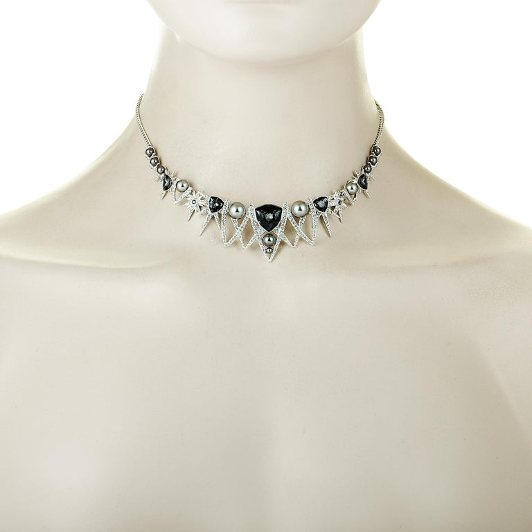"""The Swarovski """"Fantastic"""" necklace is presented with an 8.00"""" chain and a pendant that measures 6.00"""" in length and 1.12"""" in width. The necklace weighs 23.5 grams and is set with crystals and pearls.    Offered in brand new condition, this jewelry"""