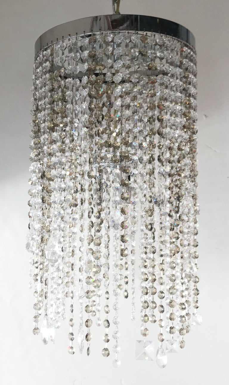 Elegant Italian flush mount with strings of smoky and clear octagonal Swarovski crystals mixed with other larger crystals in various shapes / Made in Italy 3 lights / G9 type / max 40W each Measures: Diameter 13.5 inches / Height 23 inches 1 in