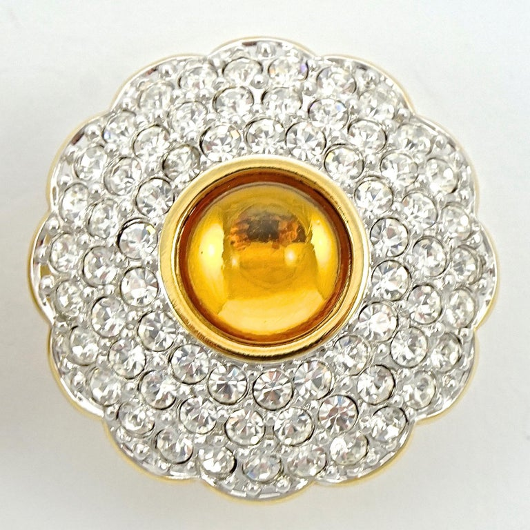 Swarovski beautiful gold plated clip on earrings set with a lovely amber centre and clear pavé crystals. The earrings are stamped with the Swarovski swan logo. Measuring diameter 2.8cm / 1.1 inches. The earrings are in very good condition, and will