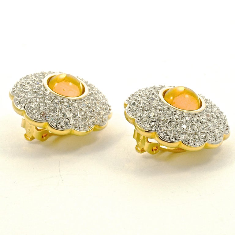 Swarovski Gold Plated Amber and Clear Pavé Crystal Swan Logo Clip On Earrings For Sale 1