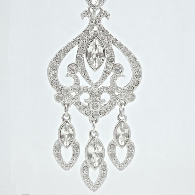 Women's or Men's Swarovski Silver Tone Marquise and Round Crystal Swan Logo Chandelier Earrings For Sale
