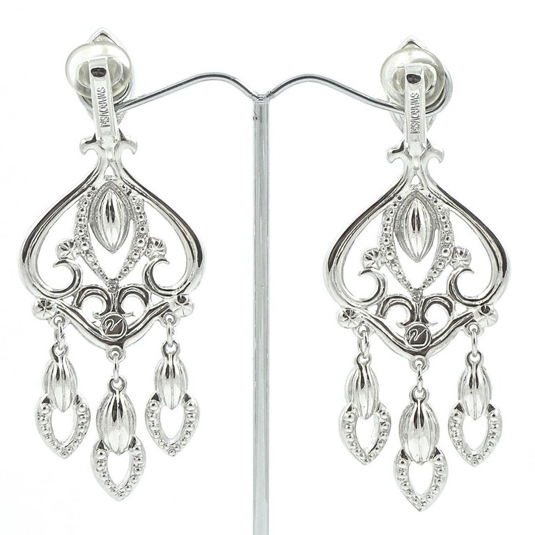 Swarovski beautiful silver tone chandelier earrings set with clear faceted marquise and round crystals. The earrings are stamped with the Swarovski swan logo. Length 7.6cm / 3 inches by width 2.9cm / 1.14 inches. The earrings are in very good