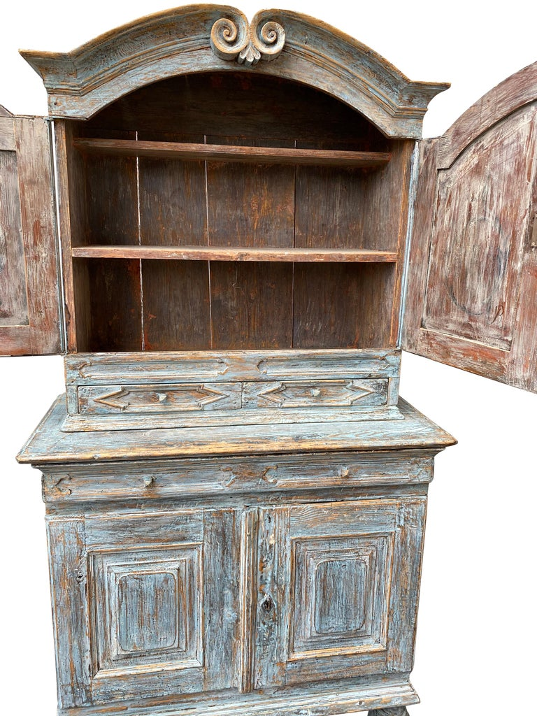 Swedish blue painted rococo cabinet, circa 1760  The cabinet has two shelves in each of the upper and lower sections. The paint is partly original and partly retouched.