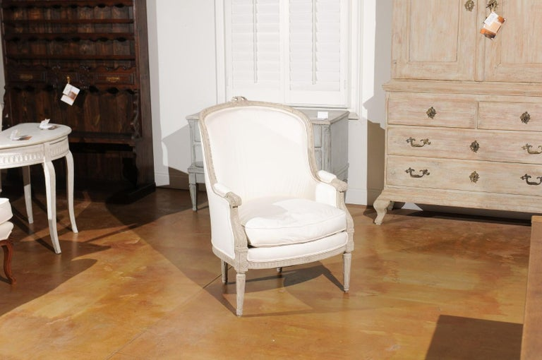 Carved Swedish 1920s Neoclassical Style Painted Barrel Back Upholstered Bergère Chair For Sale