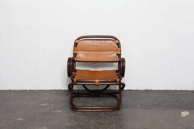Unique bamboo and original cognac leather lounge chair with buckle strapping, produced in Sweden, 1970s. Some markings on the seat.