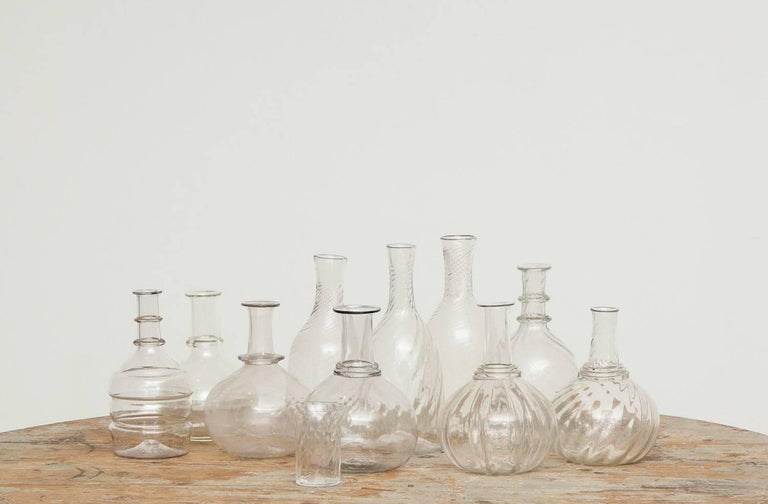 Swedish 19th century handblown turned glass carafe, origin: Sweden.  We adore these sculptural, pure, handblown glass carafes. Great objects on their own and/or added to any table setting used for wine, waters and flowers. Can never have enough of