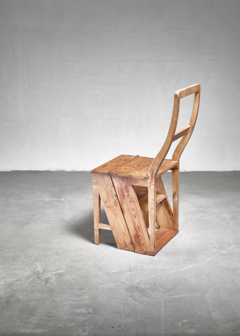A 19th century pine, foldable step chair.