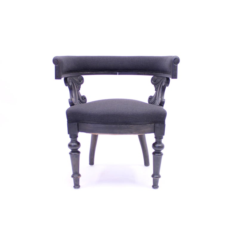 Swedish antique oak Klismos chair from the late 19the century. Very broad and robust in appearance. Side panels with carved ornaments and lathed front legs. The black paint might not be original but was done quite a long time ago and suits the model