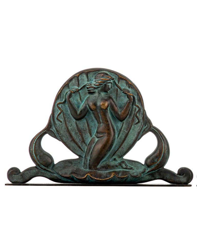 Swedish Art Deco bookends in bronze by Oscar Andersson for Ystad Metall. Bookends cast in Bronze. Made in Sweden, 1920s. The Birth of the nude Venus in a giant scallop shell. Both stamped O. A. (Oscar Andersson) and Ystad Metall.