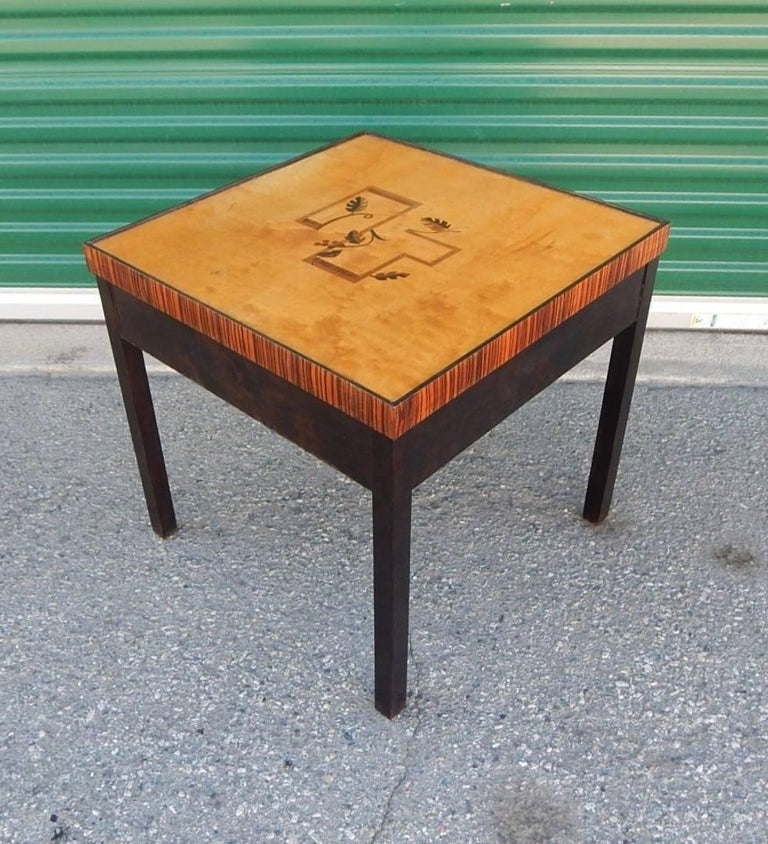 Swedish Art Deco inlaid side/end table rendered in birch wood with ebonized base.