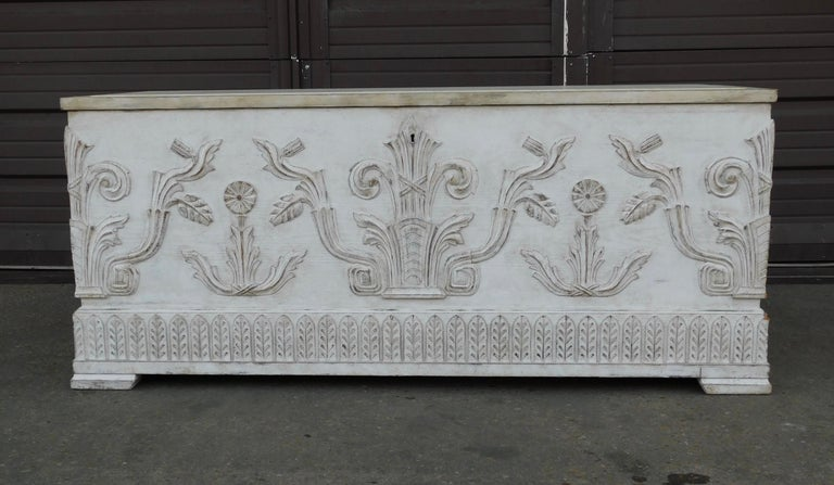Swedish Art Deco era storage chest in oak, in Gustavian style milk paint finish. With neoclassically inspired high relief. Opens from top for storage loading. In great original condition-with totally stable and sound wood joinery-ready to give a