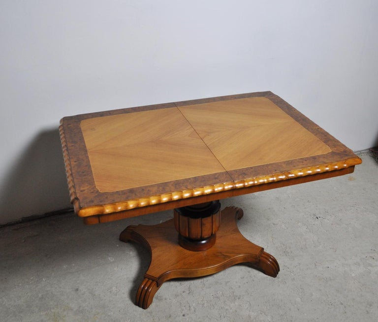 Swedish Art Deco rectangular golden elm end or side table with a detailed pedestal base. Beautifully detailed border on the top and carved edge detail.  The height is adjustable from 60,5 cm easily swivels up to 73,5 cm high. Originally, it had an