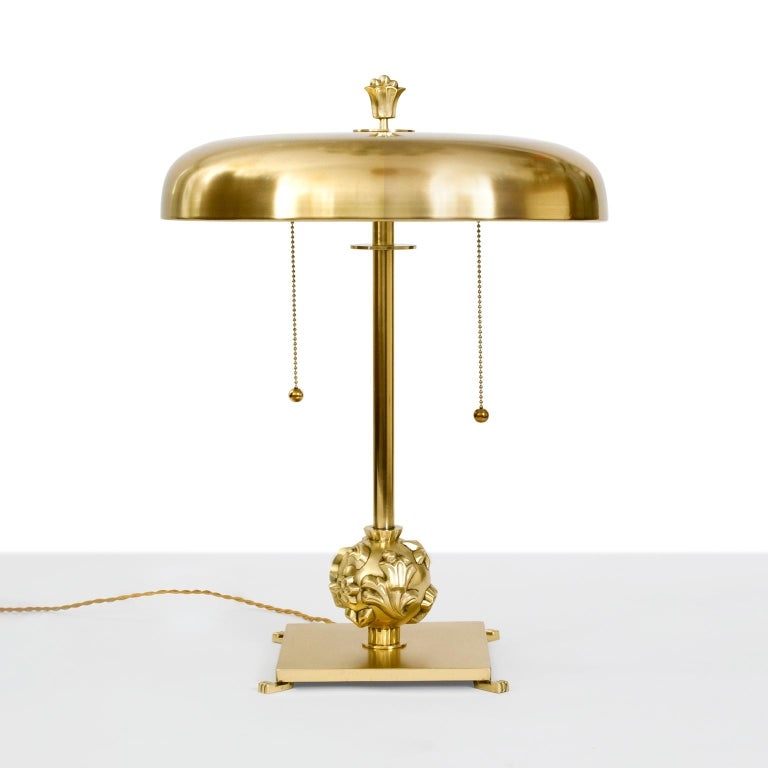 Scandinavian Modernh Art Deco polished brass table lamp designed by Elis Bergh, circa 1930 for Kosta. Bergh is known for his modernist designs which often referenced classicism. This lamp has been newly polished and lacquered with new wiring and has