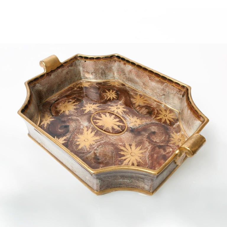 Large Swedish Art Deco tray or bowl with notched corners and handles. Hand decorated with gold glaze over a brown and green luster glaze. Designed by Josef Ekberg for Gustavsberg, signed and dated 1931.