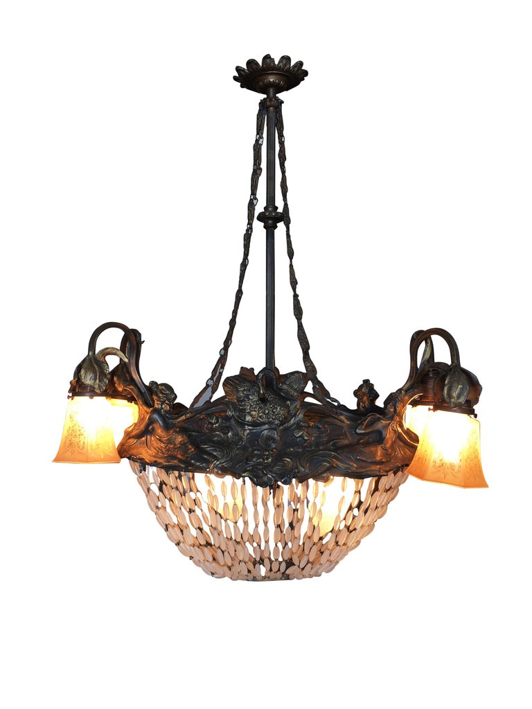 Very elegant Art Nouveau basket form chandelier from Sweden with beautiful long strands of cut crystal beads. Re-wired, cleaned and ready to hang. Includes matching chain and canopy.