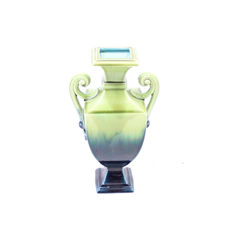 Large creamware vase / urn manufactured by Swedish porcelain gigant Rörstrand in the early part of the 20th century. It has a green/blue glaze that fades from a dark to light. Inside with turquoise glaze. Very good condition with very light ware