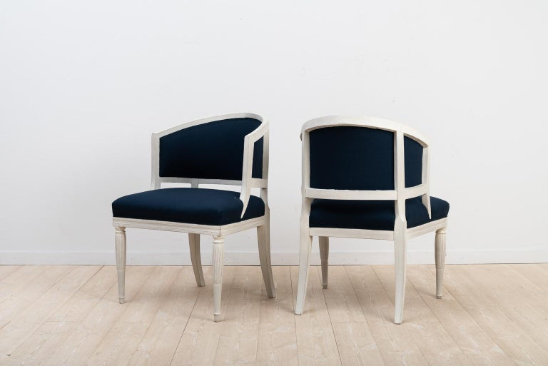 Swedish barrel back chairs in a set of two. Manufactured during the early 1800s. The chairs have been renovated with new padding and new upholstery.