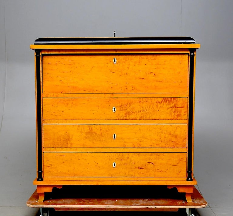 Rare Swedish Biedermeier chest of drawers writing desk chiffonier in top grade golden birch veneers in good structural condition, circa mid-1800s in age.
